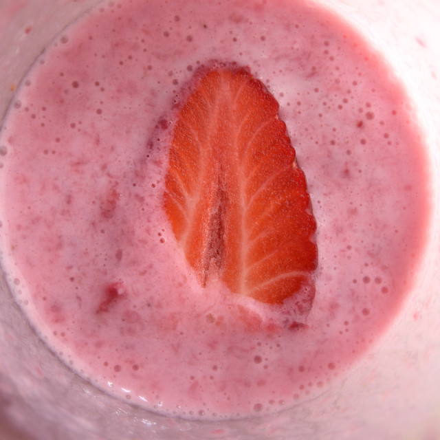 """Strawberry in Milk Shake"" stock image"