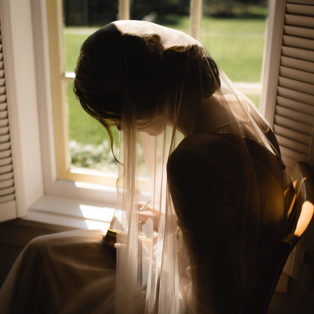 """Bride Writing a Letter to the Groom"" stock image"