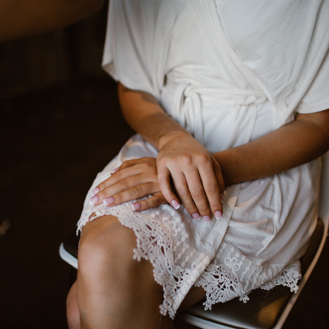 """""""Bride's Hands Waiting on Her Wedding Day"""" stock image"""