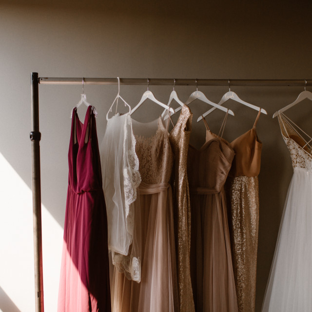 """""""Dresses hanging on a rack"""" stock image"""