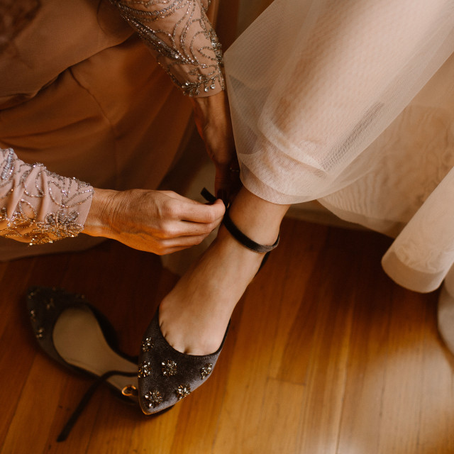 """""""Mother of the Bride Helping Her With Shoes"""" stock image"""