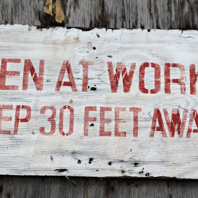 """Men at Work, Keep 30 feet away sign"" stock image"