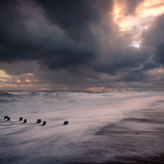 """Moody Mundesley Morning. Mundesley beach- stormy clouds"" stock image"