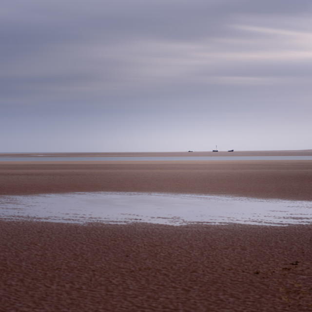 """""""Mirage. Expanse of brancaster beach at low tide, with distant shipwreck"""" stock image"""