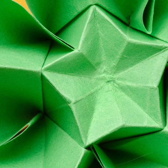 """Green paper origami flower with star"" stock image"