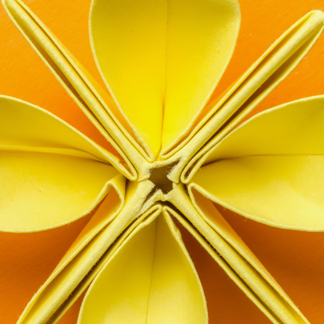 """Close-up of a yellow paper origami flower"" stock image"