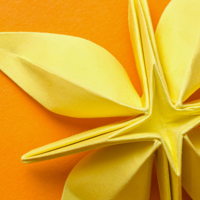 """Yellow paper origami flower with petals"" stock image"