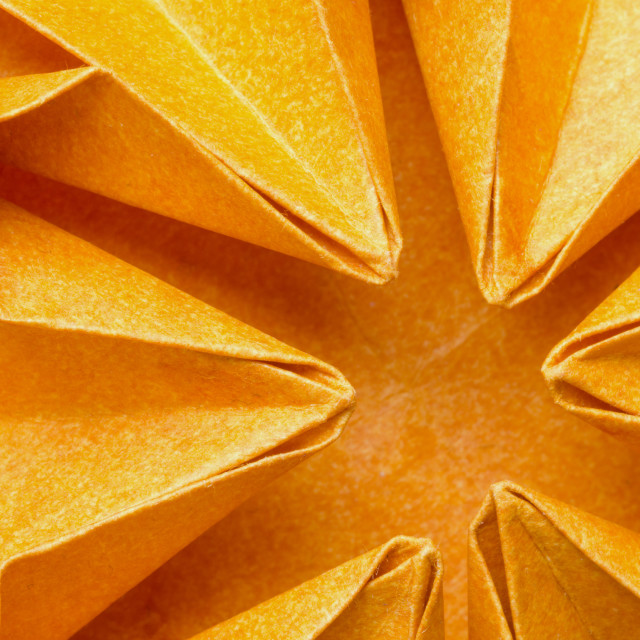 """Close-up of orange paper origami flower"" stock image"