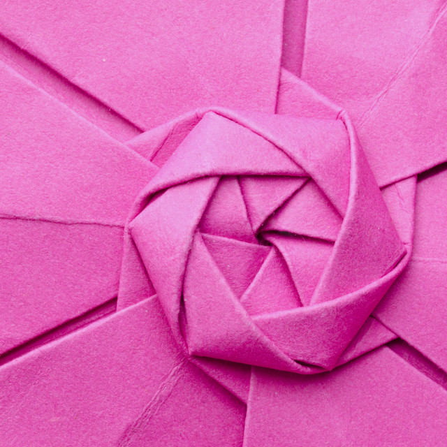 """Interesting pink paper origami flower"" stock image"