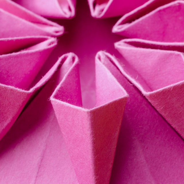 """Macro of pink paper origami flower"" stock image"