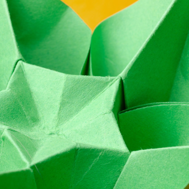 """Close-up of a green paper origami flower"" stock image"