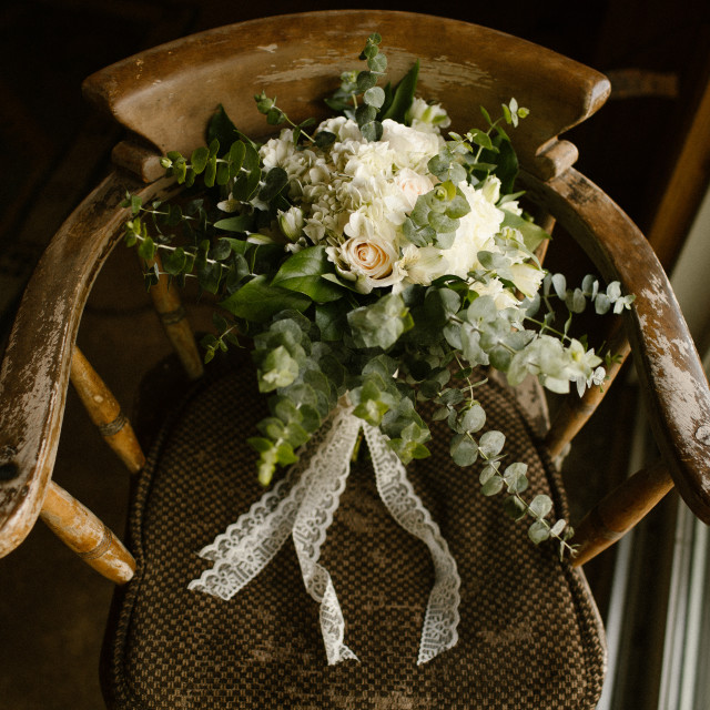 """Wedding Bouquet on a Chair Inside"" stock image"