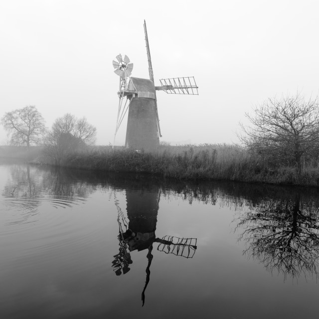 """Misty morning at How Hill mill vii- with swan"" stock image"