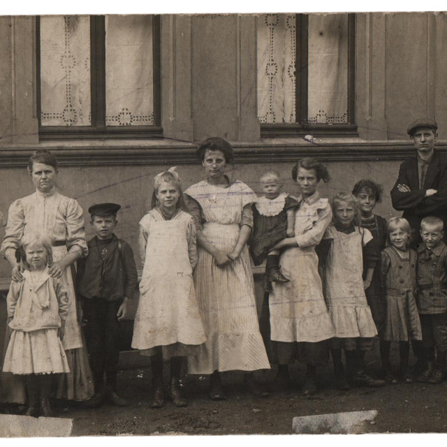 """Old family photo, parents with eleven children"" stock image"