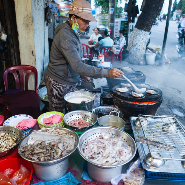 """""""Nha Trang, Vietnam - march 16 2017: street food, cooking banh xeo - savoury rice-flour pancakes with shrimp and bean sprouts"""" stock image"""
