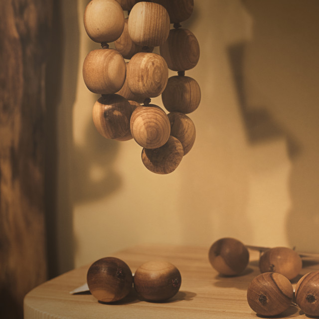 """Wood beads - wood tears on the table"" stock image"
