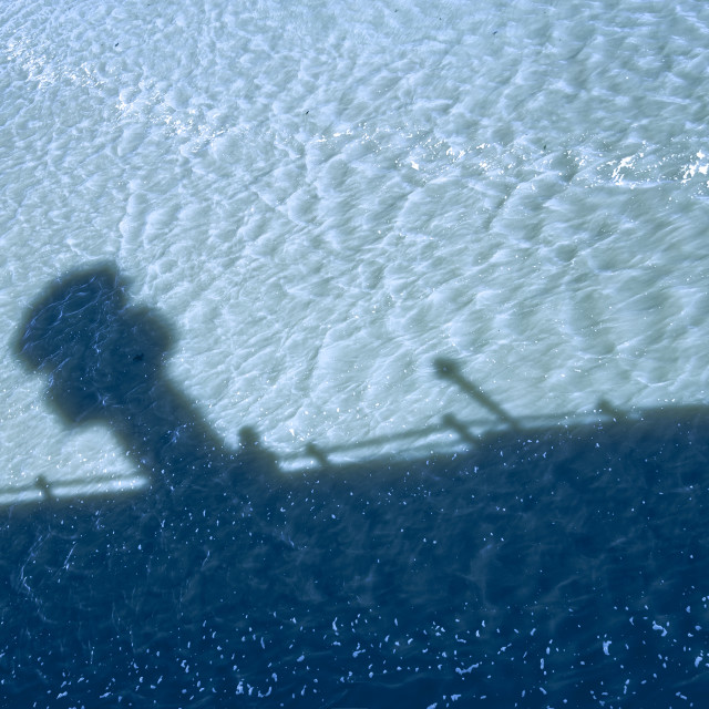 """""""Shadow selfie on the pier"""" stock image"""