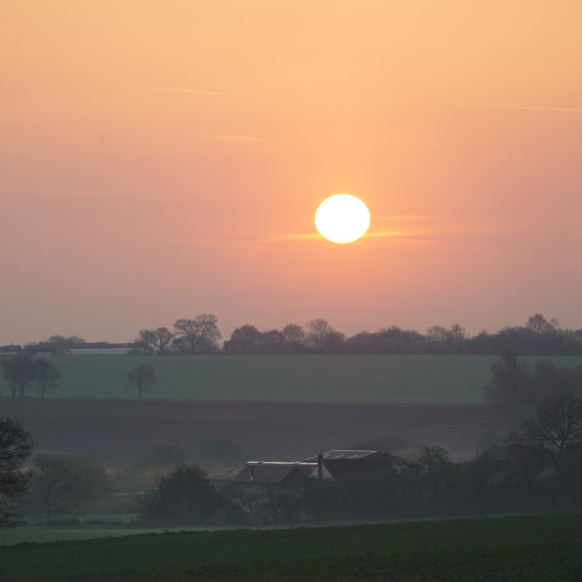 """Sunrise over the fields of Essex"" stock image"