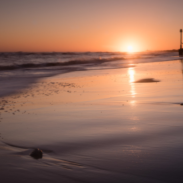 """Morning at Mundesley beach VII. Colouful dawn over low tide beach and pebbles vi"" stock image"