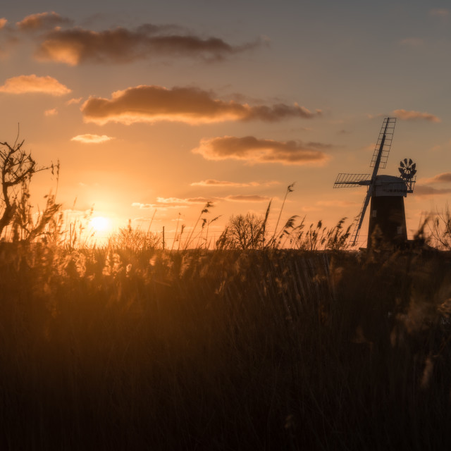 """Restored. Horsey mill with sunrise glow"" stock image"