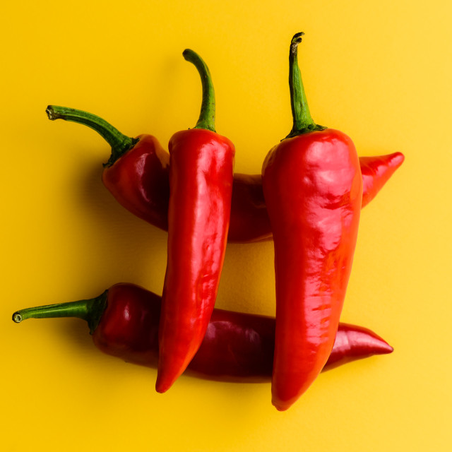 """Four chilli hashtag, yellow background"" stock image"