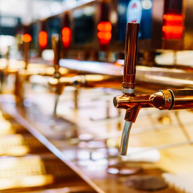 """Beer Tap Closeup In Drinks Bar"" stock image"