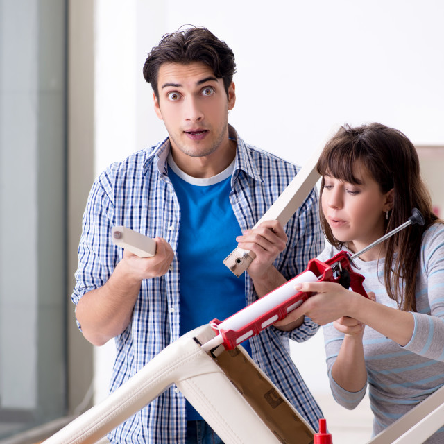 """""""The wife helping husband to repair broken chair at home"""" stock image"""