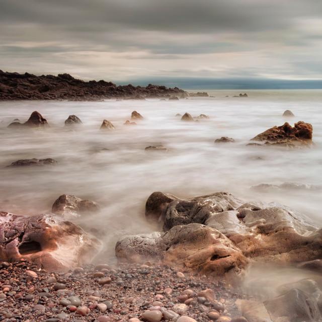 """Rotherslade Bay rocks"" stock image"