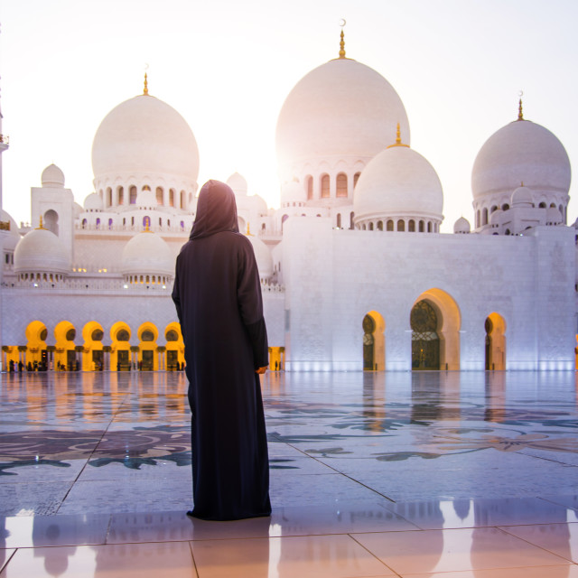 """Woman at the Grand Mosque in Abu Dhabi"" stock image"