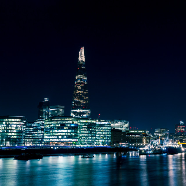 """Modern London skyline at night on River Thames"" stock image"