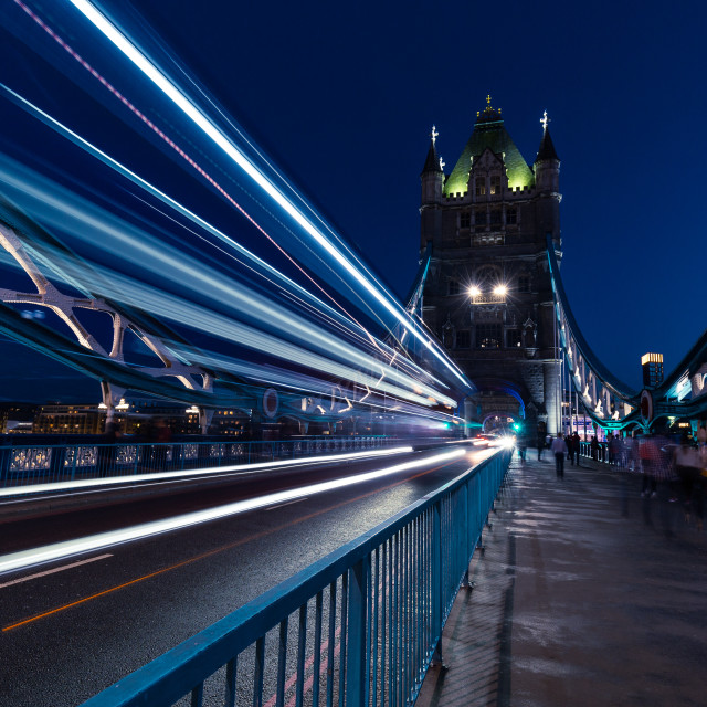 """Traffic light trails on Tower Bridge in London at night"" stock image"
