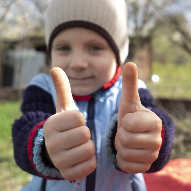 """boy holding two thumbs up"" stock image"