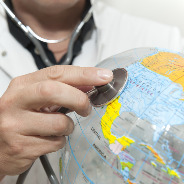 """Doctor with a beach ball globe with North America facing, concept global..."" stock image"