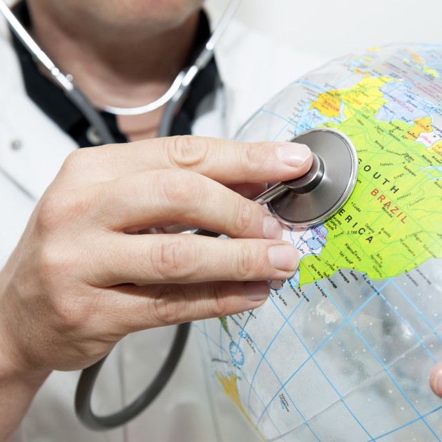 """Doctor with a beach ball globe with Soutrh America / Brazil facing, concept..."" stock image"