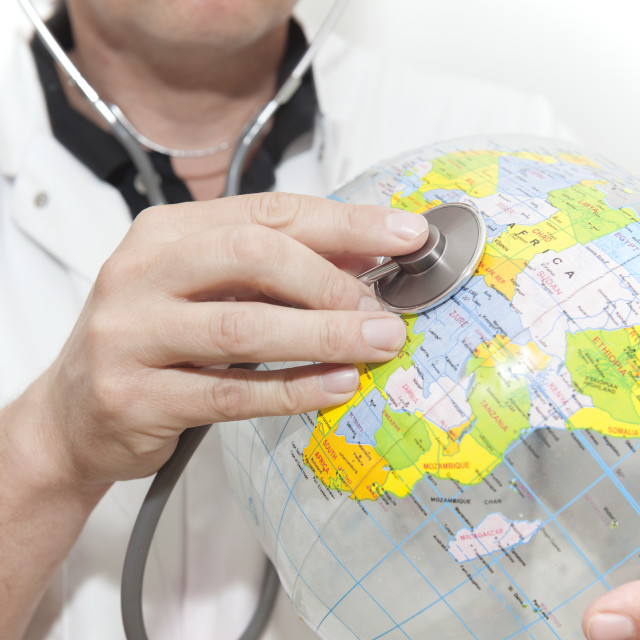 """Doctor with a beach ball globe with Africa facing, concept global health care..."" stock image"