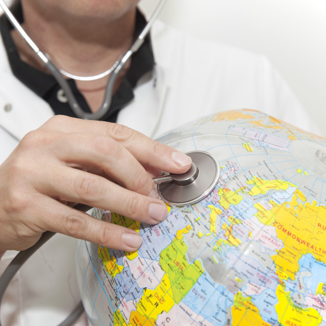 """Doctor with a beach ball globe with Europe face, concept global health care..."" stock image"