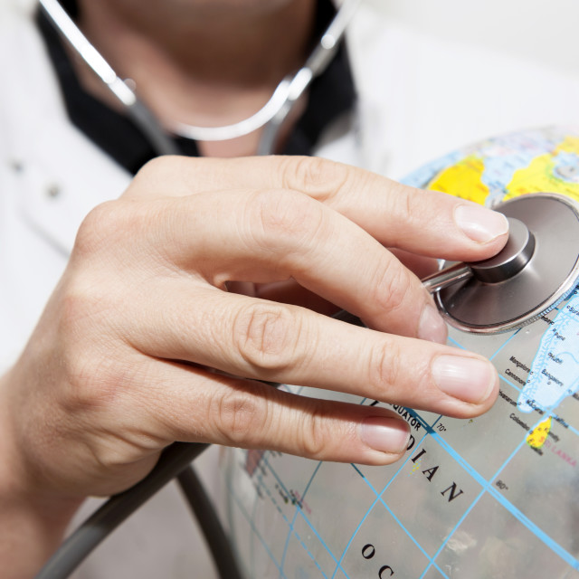 """Doctor with a beach ball globe with India facing, concept global health care..."" stock image"