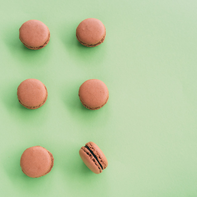 """Flat lay of macarons on green background"" stock image"