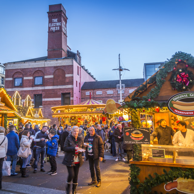 """View of visitors and Christmas Market stalls at Christmas Market, Millenium..."" stock image"