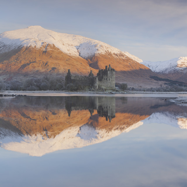 """The ruins of Kilchurn Castle seen across Loch Awe at sunrise in winter..."" stock image"