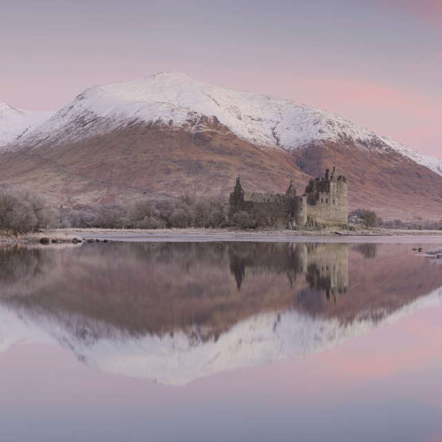 """Stitched panoramic image of Kilchurn Castle and Loch Awe at sunrise with snow..."" stock image"