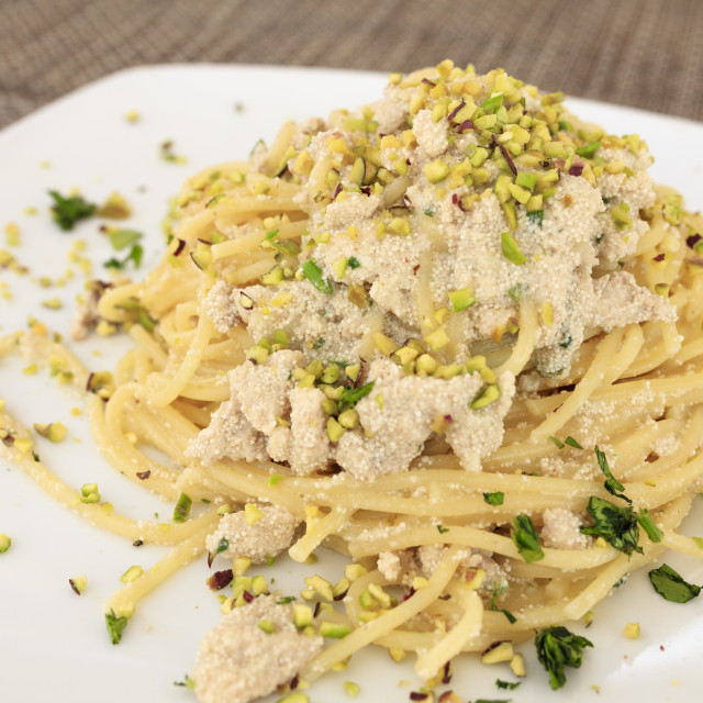 """""""Pasta on platter with swordfish eggs garnished with Bronte pistachio, Sicily,..."""" stock image"""