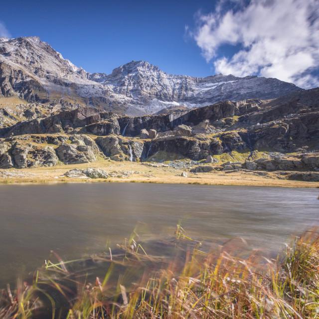 """Alpine lake during autumn, Alpe Fora, Malenco Valley, province of Sondrio,..."" stock image"
