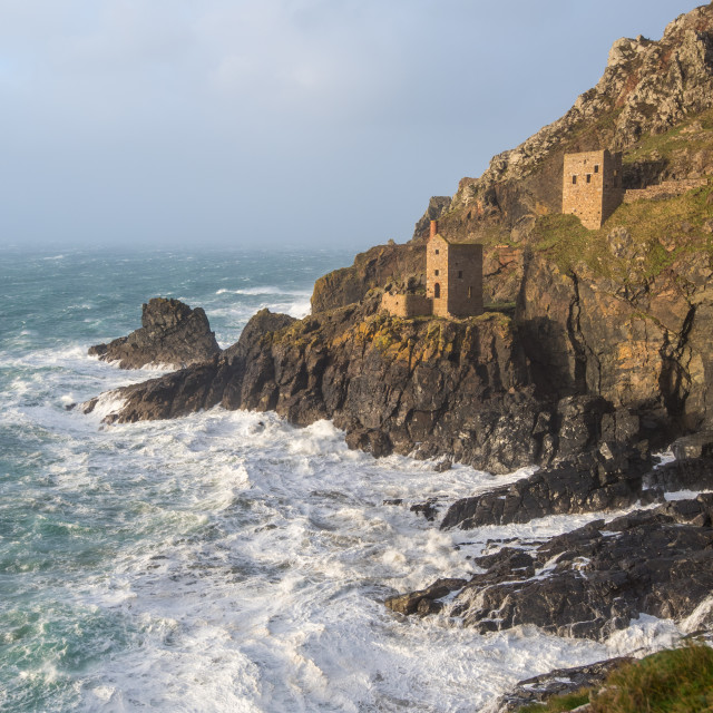 """A vertical photograph of The Crown Tin Mines in Botallack in Cornwall"" stock image"