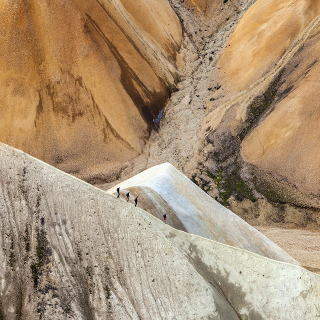 """Hikers Descending the Mountain of Blahnukur Landmannalaugar Iceland"" stock image"