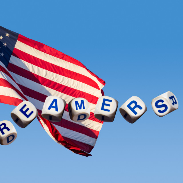 """""""Dreamers concept using spelling letters against blue sky and flag"""" stock image"""