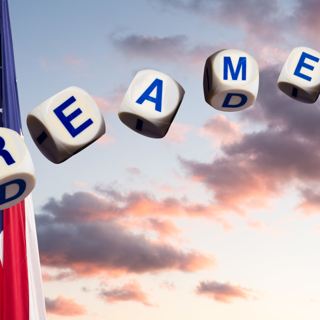"""""""Dreamers in spelling letters against sunset sky and flag and hourglass"""" stock image"""
