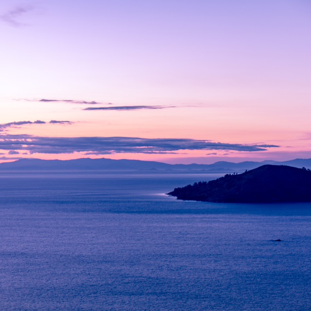 """""""Small Island at sunrise on Lake Titicaca with infinity view"""" stock image"""