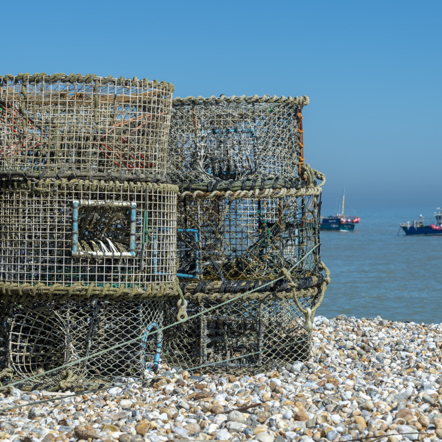 """""""Lobster & crab pots on a pebble beach at Selsy, Sussex, UK"""" stock image"""