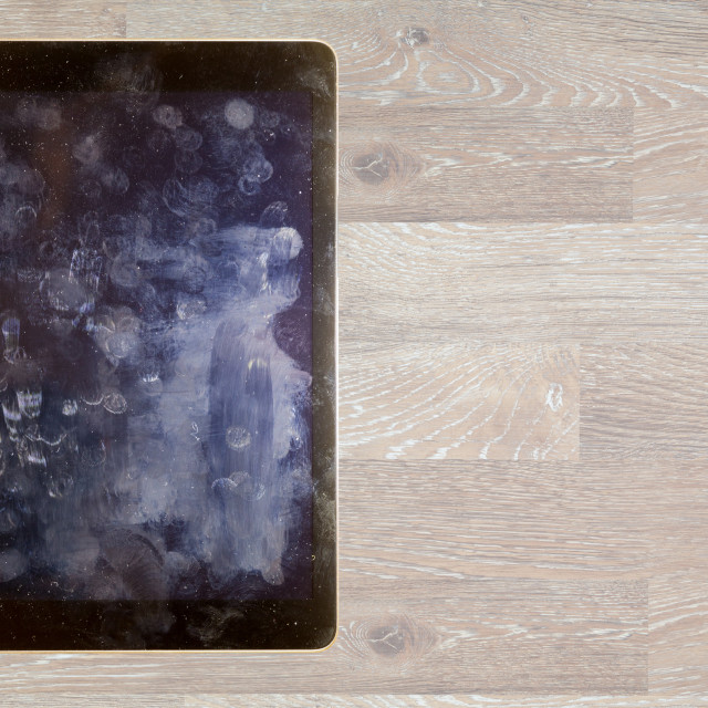 """""""View of fingerprints and grease on tablet screen"""" stock image"""